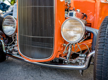 Epic Vintage Orange Retro Car With Open Wheel Suspension And Headlights On The Sides Of The Car Body