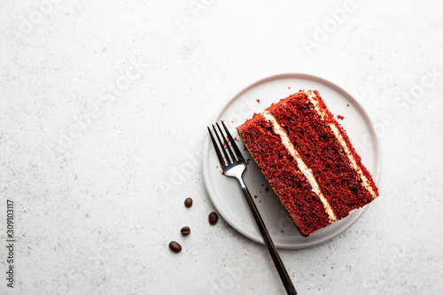 Fotografia, Obraz Top view of slice of red velvet cake with copy space on white background