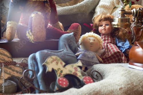 Fotografia, Obraz Suitcase with toys and dolls (Teddy bear) . Vintage style