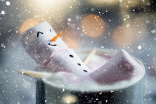 Cute Little Snowman Made From Marshmallows Bathing In A Mug With Hot Chocolate