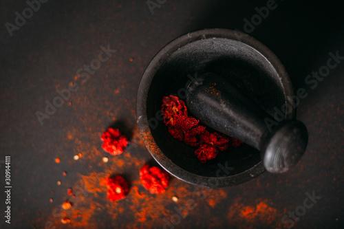 Fotografia, Obraz Red spicy dry carolina reaper. Dark food photography. Copy space.