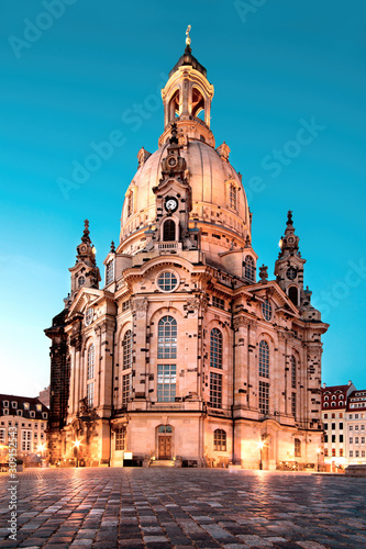 Illuminated Church of Our Lady, or Frauenkirche, at night in Dresden, Germany, on a quiet evening with blue sky. Famous travel landmark and symbol of Peace in Saxony, Germany.
