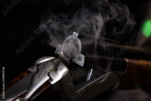Photo Smoking hunting gun or shotgun, clay pigeon shooting, Aviemore, Scotland, UK