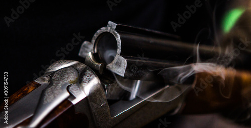 Smoking hunting gun or shotgun, clay pigeon shooting, Aviemore, Scotland, UK Wallpaper Mural
