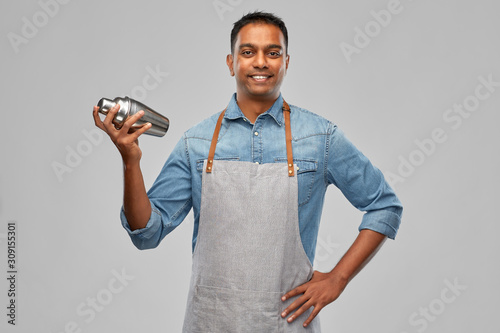 alcohol drinks, people and profession concept - indian barman in apron with cock Canvas Print