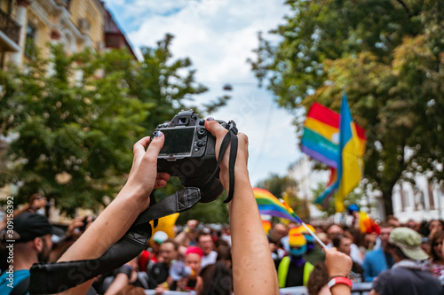 Correspondent takes photo during the Gay Pride parade Canvas Print