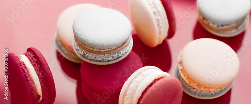 Cuadros en Lienzo French macaroons on wine red background, parisian chic cafe dessert, sweet food
