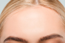 Close Up Of Forehead With Perfect Skin Of Young Woman
