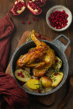 Roasted Guinea Fowl With Pomegranate, Rosemary And Baked Potatoes