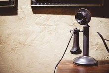 Vintage Telephone On A Wooden Surface