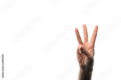 Valokuvatapetti cropped view of woman showing three fingers isolated on white