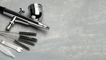 Airbrush Cleaning. Brushes And Other Airbrush Cleaning Tools. Copy Space For Text.