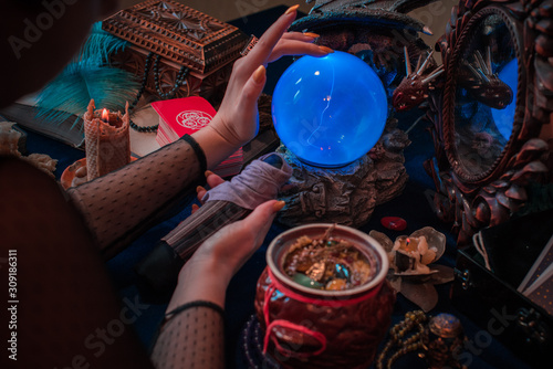 Fotografie, Obraz Tarot cards and crystal ball, candles, witch magic bottles