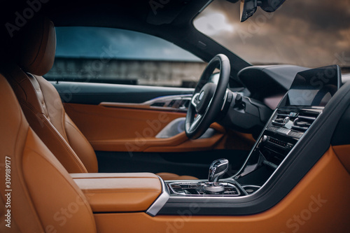 Modern supercar interior with leather panel, multimedia and dashboard Canvas Print