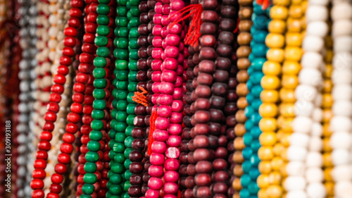 Photo Colorful wooden beads for sale at market