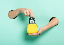 Female Hands Hold Alarm Clock ...