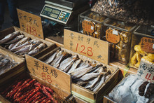 Fish And Sausages For Sale On Street Food Market