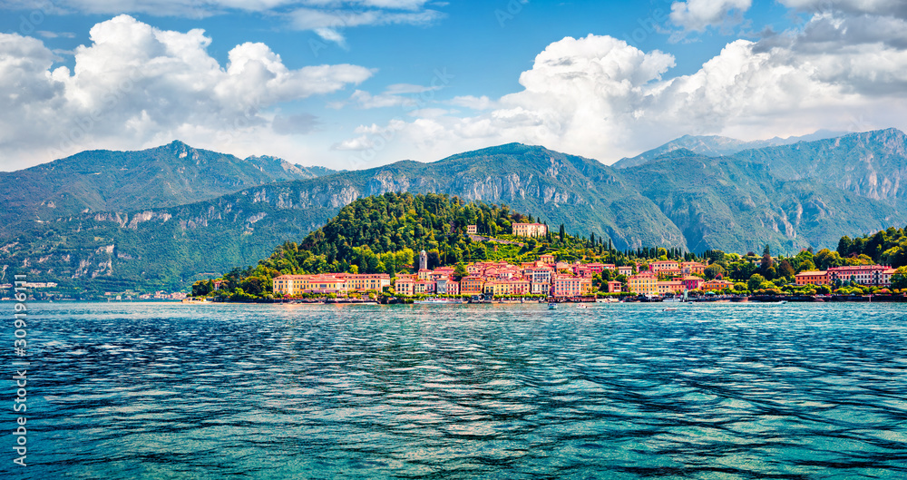 Fototapeta Popular tourist destination - Bellagio town, view from ferry boat. Superb morning scene of Como lake, Italy, Europe. Traveling concept background.