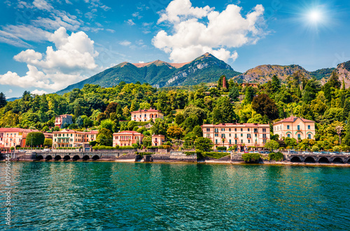 fototapeta na szkło Picturesque summer view from ferry boat of Cadenabbia town. Bright morning scene of Como lake, Italy, Europe. Traveling concept background.