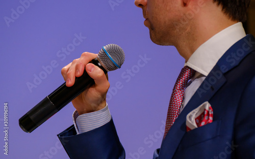 Man speaks, holding a microphone Canvas Print