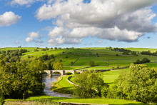Burnsall View Of The Bridge Over The River Wharfe In The Craven District Of The North Yorkshire Dales