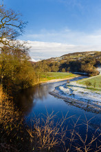 River Wharfe At Bolton Abbey In The North Yorkshire Dales National Park In Winter With A Light Dusting Of Snow