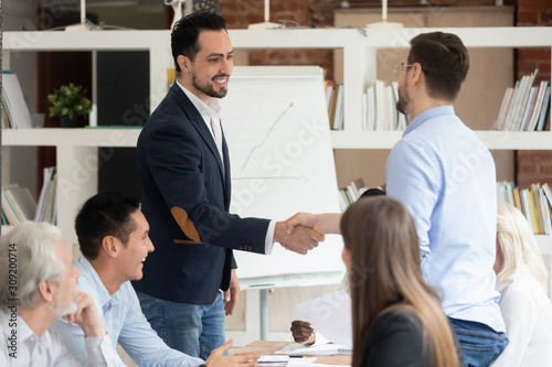Multi racial businessmen shaking hands closing deal Wallpaper Mural