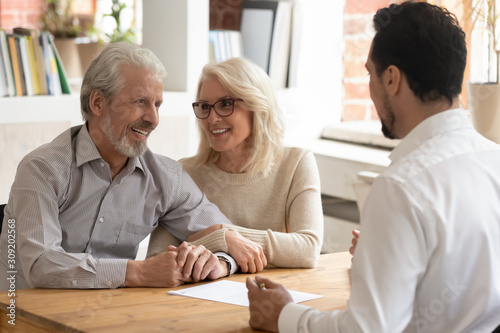 Fotomural Elderly spouses during meeting with banker or real estate agent