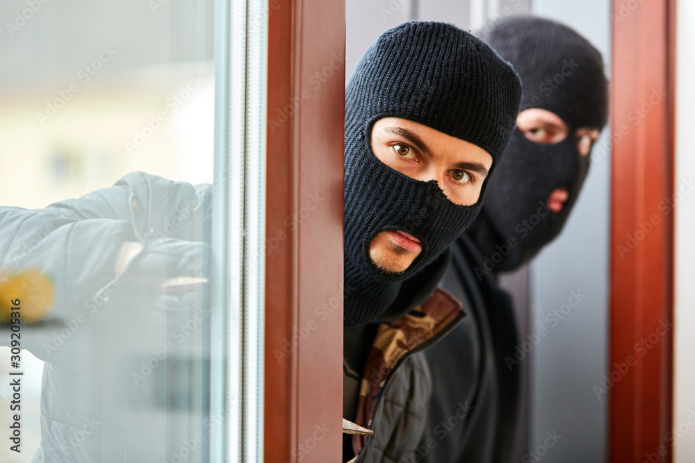 Fototapeta Burglars open patio door from the house