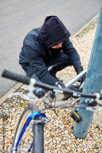 Steal bicycle thief on bicycle - 309205544