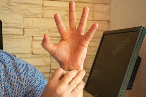 Concept photo of pain in the wrist or forearm, which is accompanied by carpal tunnel syndrome, compression or other nerve or arm joints disease Wallpaper Mural