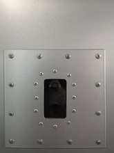 Vintage Video Camera Hidden Behind Steel Panels. Mecanical Engineering Pattern With Bolts And Rivets Around The Perimeter. Abstract Industrial Template With Metal Powder Coating Texture Background.