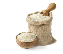 Dry White Long Rice Basmati In Wooden Bowl And Burlap Sack With Wooden Scoop Isolated On White Background.