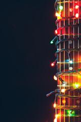 guitar finger-board with multicolor lights, festive background