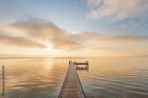 Fototapeta Sunset Starnberger See with Pier and Clouds obraz na płótnie