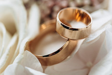 Two Wedding Ring On Flowers