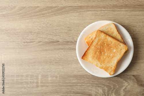 Plate with toasts on wooden background, top view Wallpaper Mural