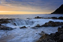 Water Rushing Into Thor's Well During Dramatic Sunset Cape Perpetua Oregon Coast