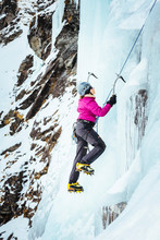 New Zealand, Otago, Wye Creek Basin. A Woman Is Ice Climbing On The First Pitch Of 'The Iron Curtain'.