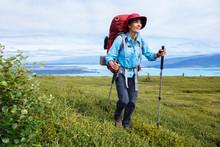 A Woman Hiking Above Lake Telaquana In Lake Clark National Park And Preserve, Alaska, USA
