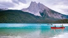 Couple Canoeing On The Lake Du...