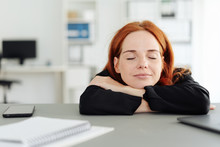 Serene Young Woman Closing Her Eyes At The Office