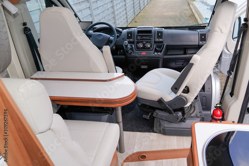 fototapeta na szkło Camper Dining Room front van seat vanlife and steering wheel