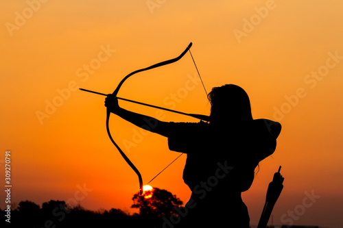 Photo the archer whose arm appears to be and