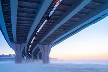 Bridges. Winter Panorama From Under The Bridge. The Construction Of Bridges. Winter City Landscape. Concept - Bridge Maintenance. Bridge Supports. City Architecture. Frozen River Frozen Channel. Snow