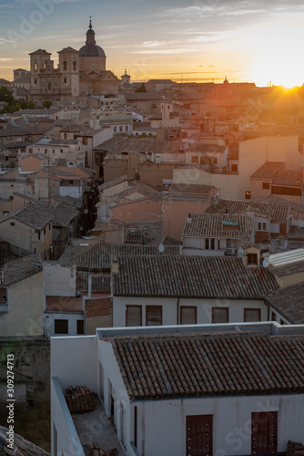Toledo is an ancient city set on a hill above the plains of Castilla-La Mancha in central Spain. The capital of the region. Vertical in sunset.