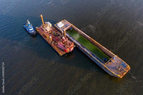 Fényképezés Aerial view of river dredging equipment in St. Johns River.