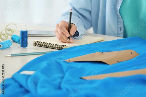Fototapeta Female designer working in studio, closeup obraz na płótnie