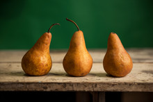 3 Bosc Pears On Table