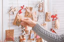 Woman Making Christmas Advent Calendar